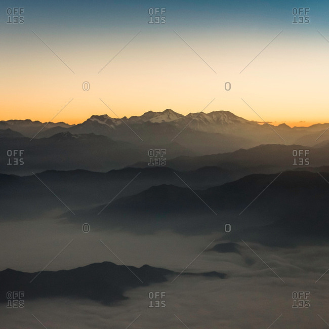 Aerial view of sunset over mountains, Metropolitan Region, Chile