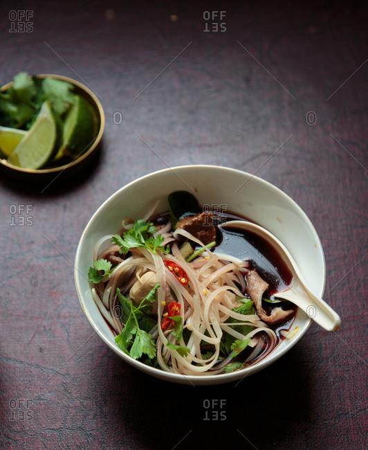 Thai boat noodle soup in bowl