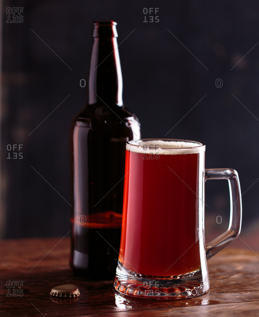 Glass of red ale and bottle