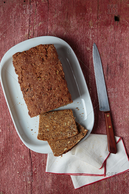 Filmjolkslimpa (seeded buttermilk bread) with a knife