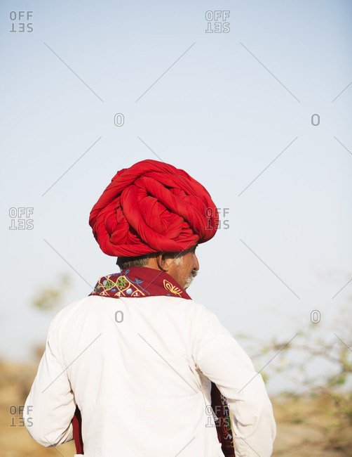 Jawai, Rajasthan, India - May 19, 2015: Rabari herdsman at sundown rounding up their goats