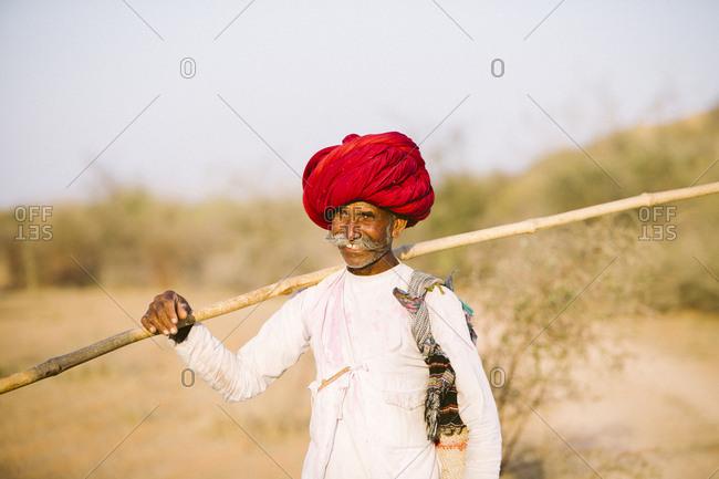 Jawai, Rajasthan, India - May 19, 2015: Rabari herdsmen at sundown rounding up their goats