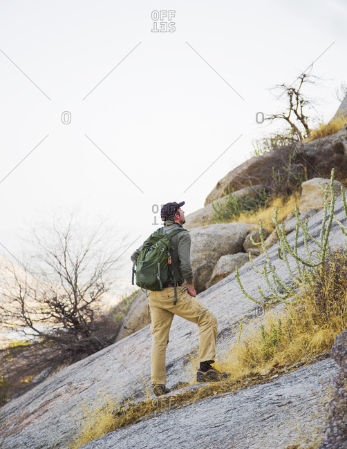 Jawai, Rajasthan, India - May 20, 2015: Hiking up a hill to see the panorama