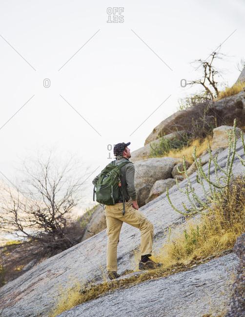 Jawai, Rajasthan, India - May 20, 2015: Hiking up a hill to see the panorama