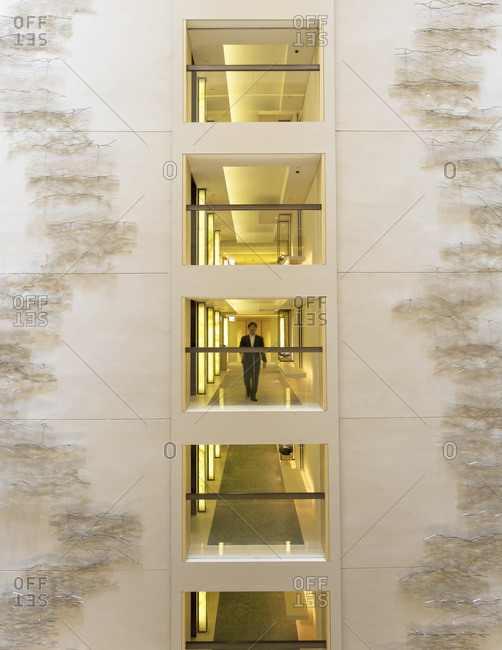 "Hong Kong, China - November 16, 2015: The atrium at the Upper House has a metal wall artwork ""Rise"" by the Japanese artist Hiroshiwata Sawada"