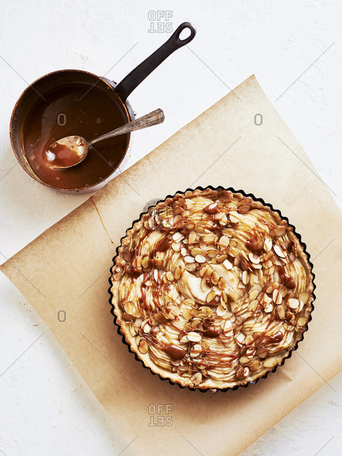 Pear tart with caramel sauce and almonds