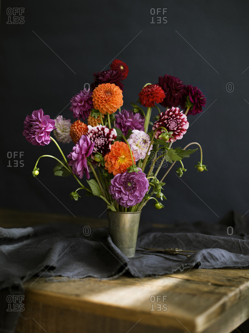 A bouquet of Dahlias in a metal vase