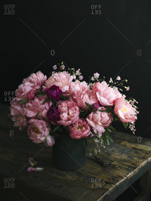 A bouquet of blooming pink peonies