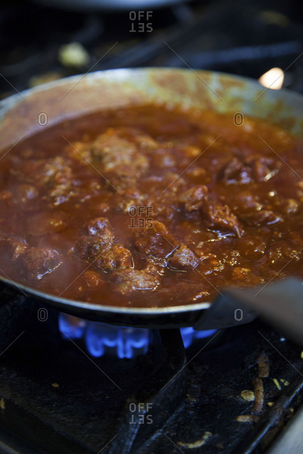 Carne guisada being cooked on a stove