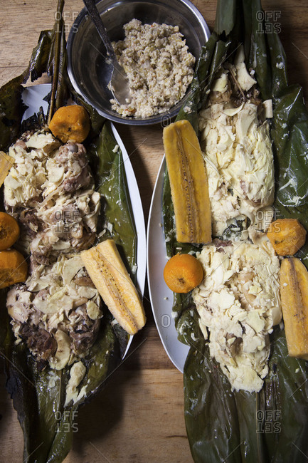 Charred banana leaf with fish and plantains