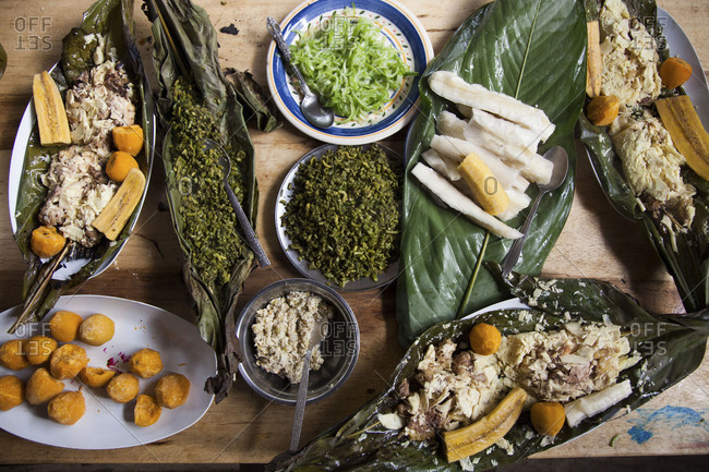 Ecuadorian dinner with fiddlehead fronds, fish, plantains, yucca