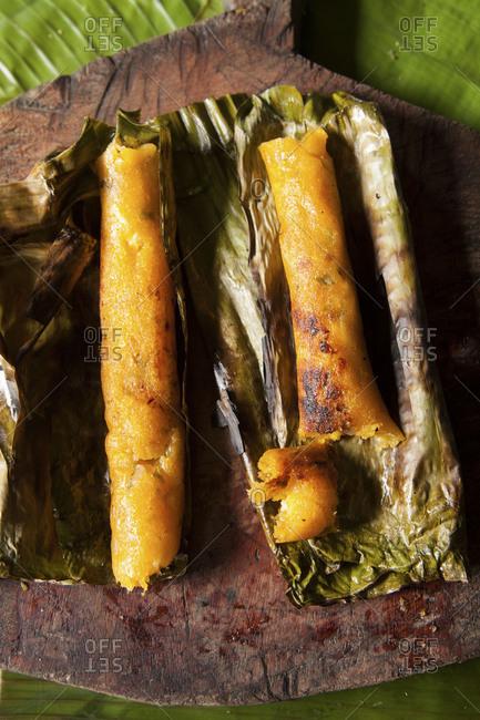 Two charred Ecuadorian corn cake tamale