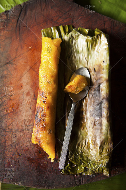 Charred Ecuadorian corn cake tamale with spoon