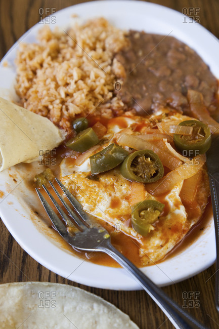 Huevos rancheros with rice and beans