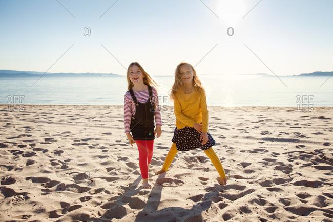 Two little girls on a sandy beach