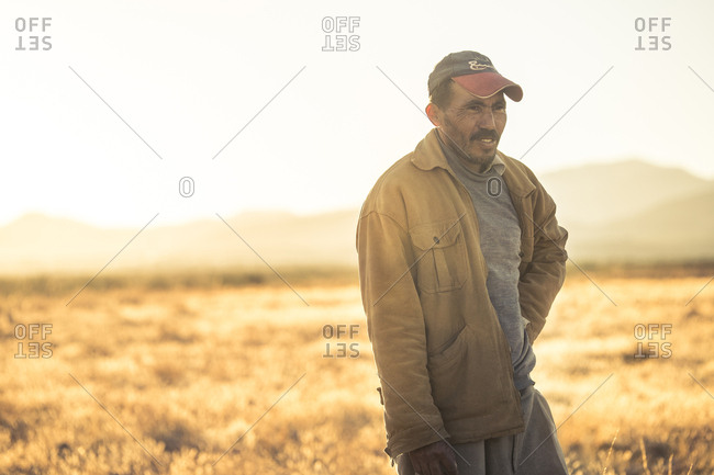 MOROCCO - AUGUST 15, 2017: Adult native man standing in prairie and looking away