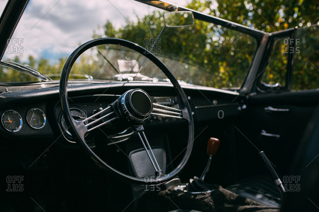 Classic car steering wheel and dashboard