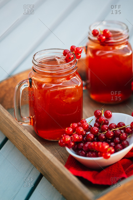 Red currant beverage in mason jar