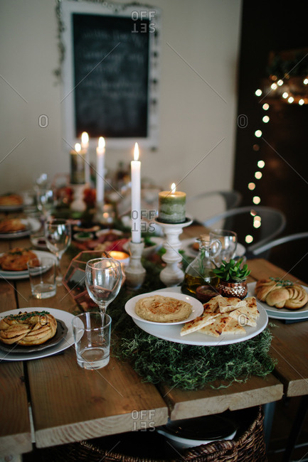 A holiday table with hummus and pita