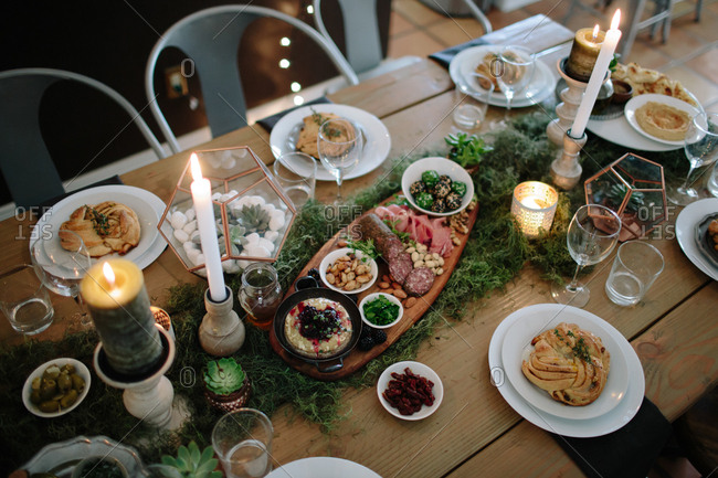 A holiday table with appetizers and bread