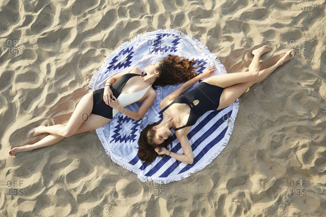 Mother and daughter relax at beach