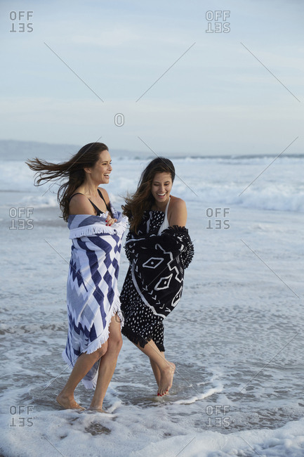 Mother and daughter play in the surf