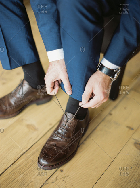 Person tying dress shoes