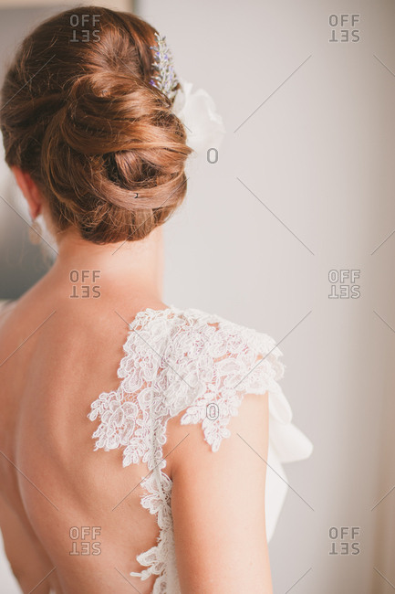 Back view of bride with brown hair in wedding gown