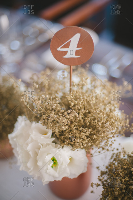 Centerpiece with number on table at wedding reception