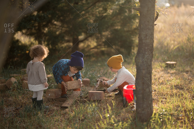Three children playing outside