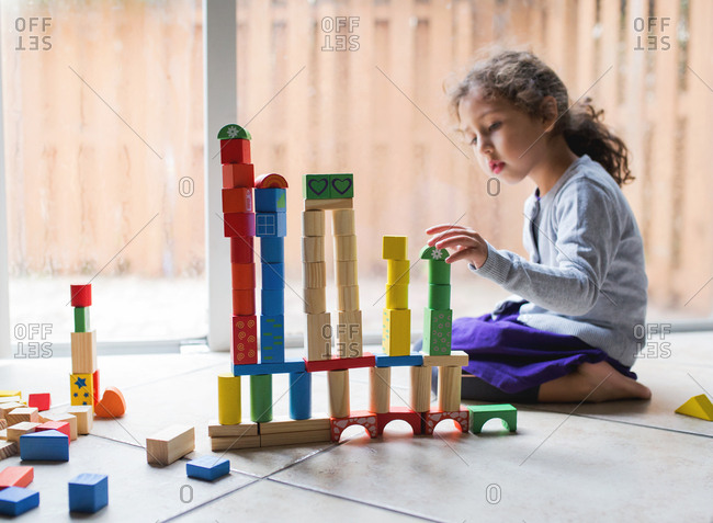 Girl plays with colorful blocks