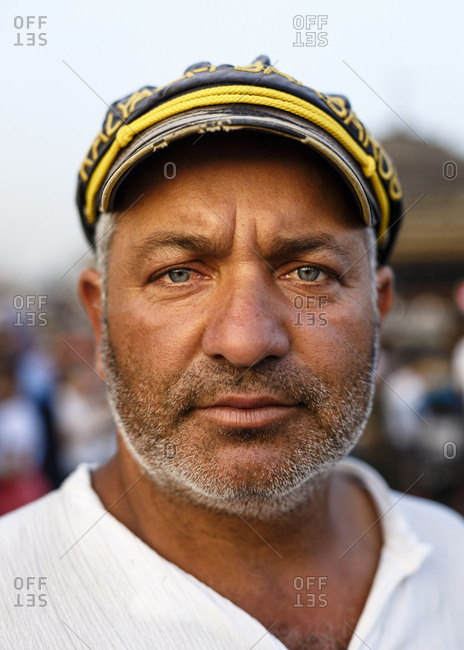 Istanbul, Turkey - September 10, 2017: Portrait of a fisherman working at the boats selling Balik Ekmek (fried fish) sandwiches in Eminonu