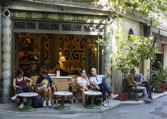 Istanbul, Turkey - September 13, 2017: People sitting at Karbatak cafe in Karakoy
