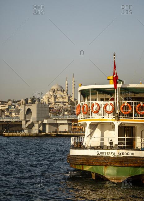 Istanbul, Turkey - September 15, 2017: Ferry in Karakoy docking station with a view over Suleymaniye Mosque (Suleymaniye Camii)