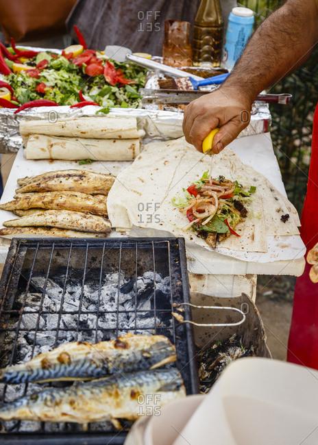 Stall making Ekmek Balik (grilled fish sandwich), Istanbul, Turkey