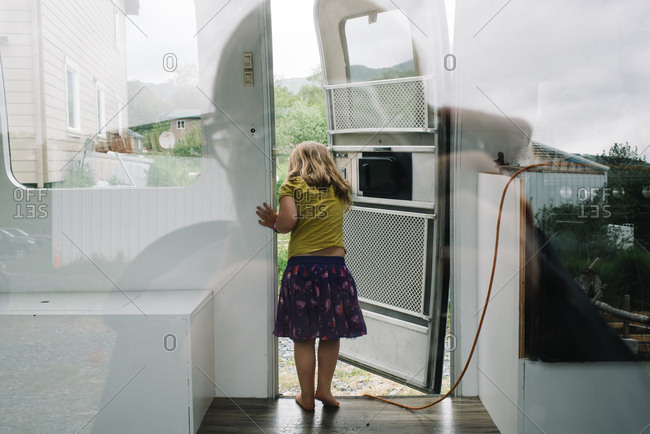 Girl looking out camper van door