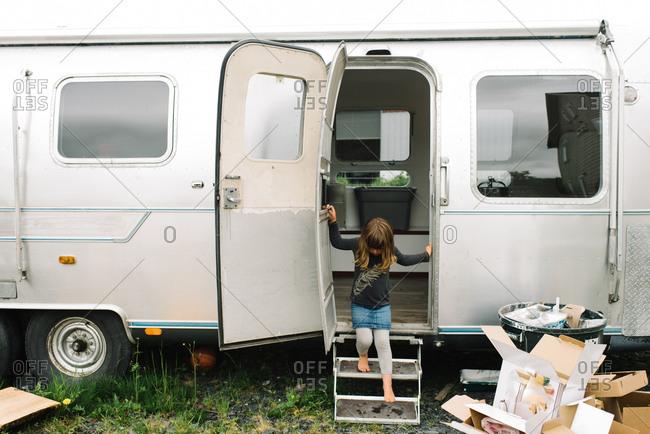 Girl coming out of camper van