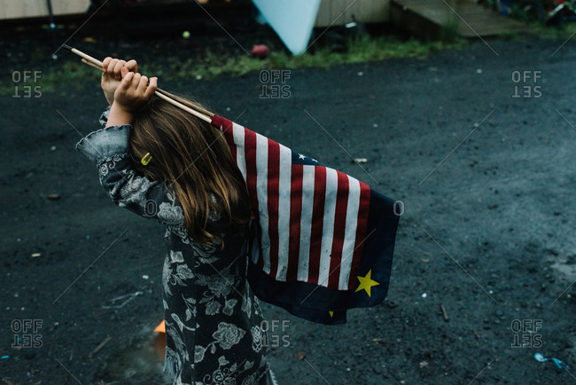 Girl walking around with American flag