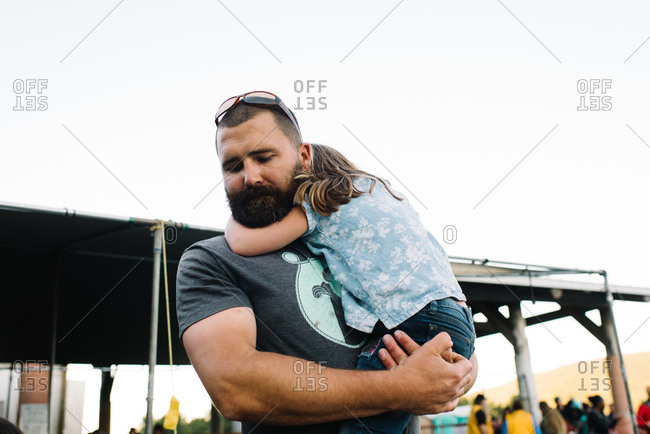 Girl resting in father's arms