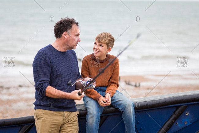 Father teaching son how to fish