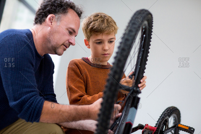 Boy fixing bike with his Dad