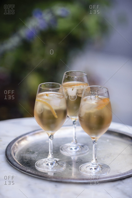 Spritz cocktails with orange on a serving tray