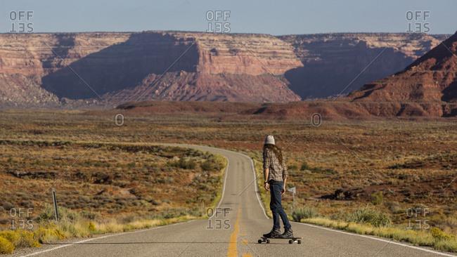 Man skateboarding down an open highway