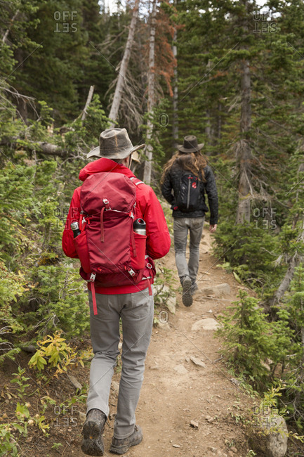 Two men hiking a trail in the mountains