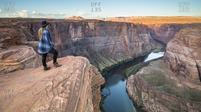 Woman overlooks Horseshoe Bend