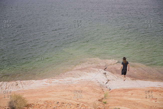 Person walking near the shore of Lake Powell