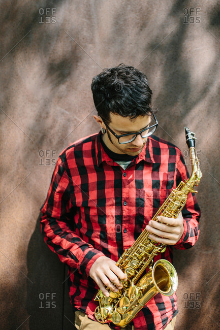 Young musician with sax
