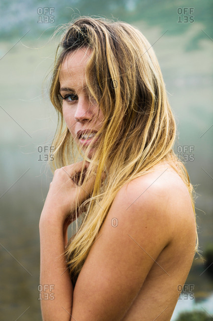Topless woman at lake