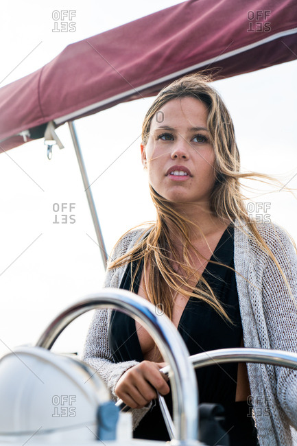 Girl at the helm on a yacht