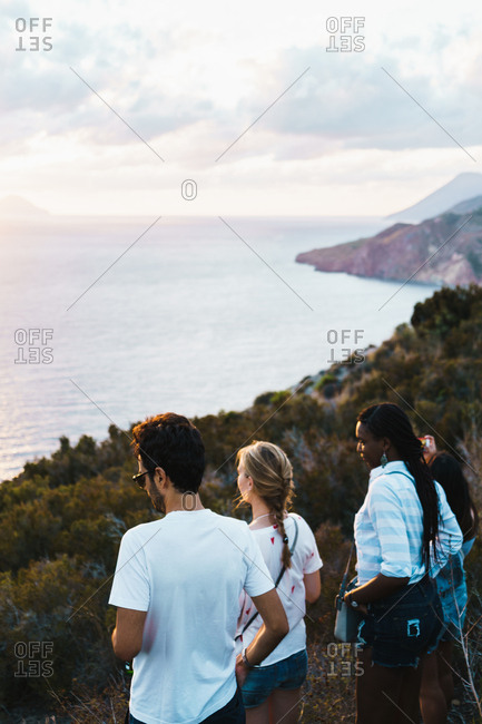 Group of people standing on cliff